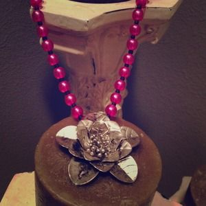 Pink and black flower necklace.