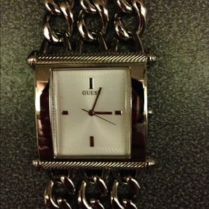 Silver chain link watch. Needs battery.