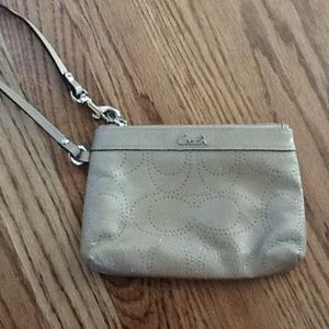 Authentic Coach tan/beige cutout large wristlet