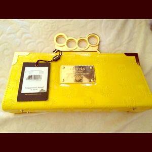 "Akdmks patent leather ""brass knuckle"" clutch"