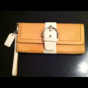 Coach Clutches & Wallets - White and tan Coach clutch with wrist strap.