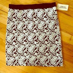 Black and white flowered high waisted mini skirt
