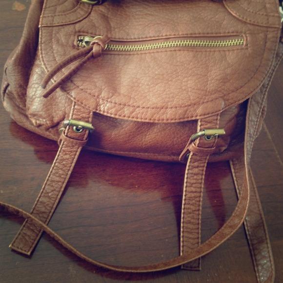 4554c2da11c125 Brown over shoulder purse. icing. M_5112bc3ae4b04e8819c9a21d.  M_5112bc3ae4b04e8819c9a21d