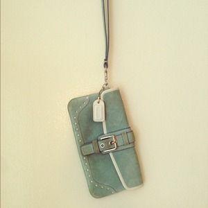 Coach Handbags - Coach light blue suede wristlet