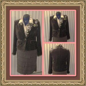Brown velvet and silk blazer with ribbon rosettes.