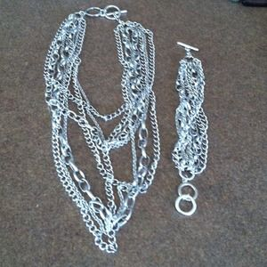 Jewelry - Silver tone multi-chain necklace and bracelet set.