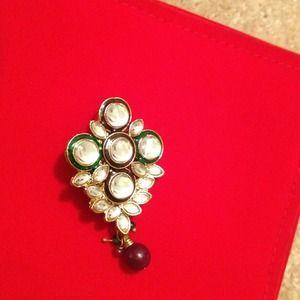 White sparkling gem studded broach !!