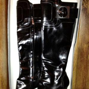 Black leather platform boots.