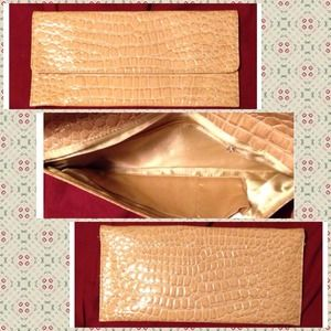 Beige alligator clutch