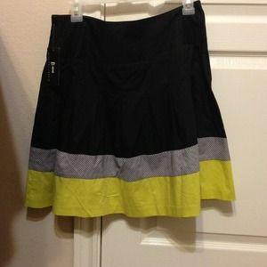 Black, green, and grey above knee length skirt.