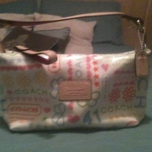 ---Auth. Coach makeup bag. Never used