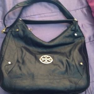 **NOT SELLING** Looking to buy this Tory Burch.