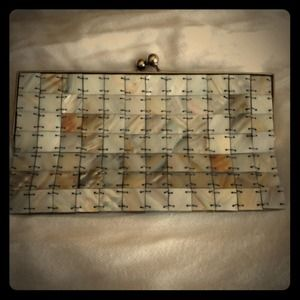 Clutch - mother of Pearl with  silk lining.