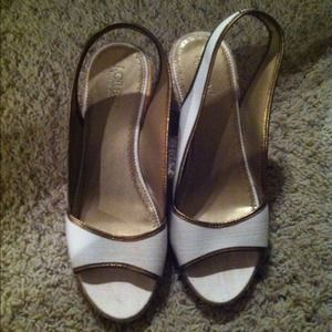 Beige jcrew wedges with gold detail. Never worn.