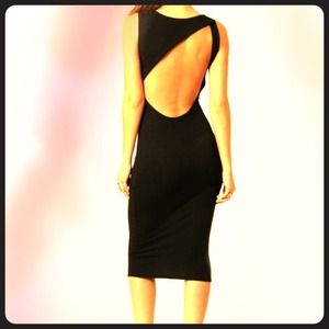 Dresses & Skirts - 📛SOLD📛 Sexy cut out back mid calf dress!