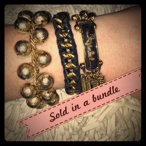Set of TWO Henri Bendel black and gold bracelets
