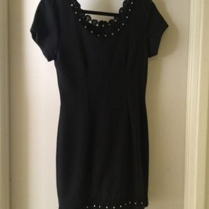 Black dress with scalloped detailing, soft fabric