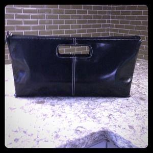XOXO black faux leather clutch.