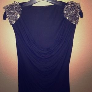 Black Express top with beaded shoulder accent.