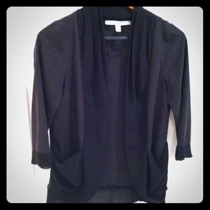 Pretty black silky jacket with pleating on lapel