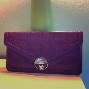 NWOT Magenta color with silver buckle clutch