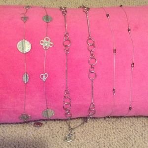 Bundle of 3 long silver necklaces.