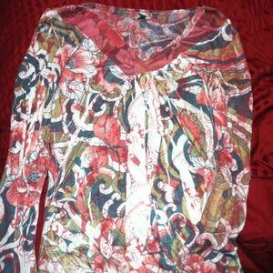 Sheer long sleeve blouse.