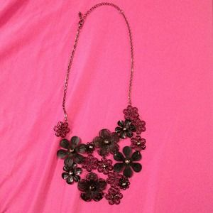 Black flowered adjustable necklace.