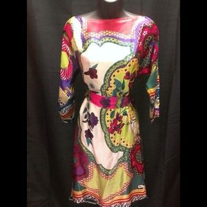 Cache print Dress size M. New with tags!