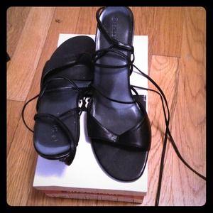 Black open-toe tie-up sandals