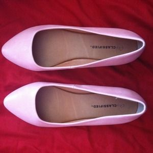 Pink pointed-toe flats
