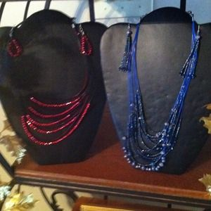 Two necklace/earring sets