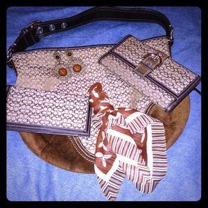 Coach half moon brown handbag.