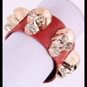 Jewelry - temporarily out of stock****Red cuff with skulls