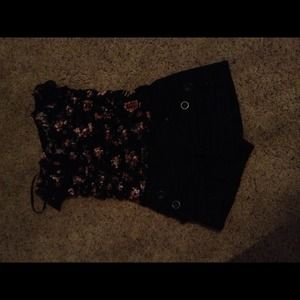 Black shorts and floral shirt