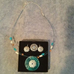 Avon  Jewelry - NWOT...Necklace, earrings and ring set.