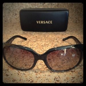 Versace black sunglasses with hard case.