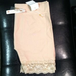2 pair of lace shorts. Nude and black.