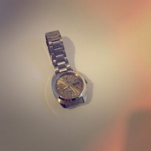 Never worn silver over-sized watch