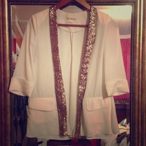 White blazer with a gold sequence