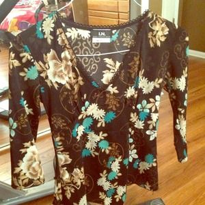 All clothes must go!! Pretty black flower top!