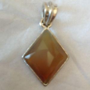 Jewelry - A light brown stone pendant