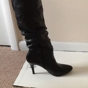 Aldo black leather boots ..