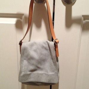 Light blue suede coach bag