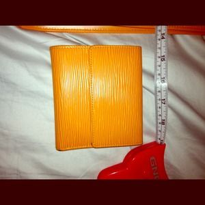 Authentic Louis  Vuitton Epi Tangerine wallet