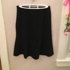 Black high waisted knee length skirt