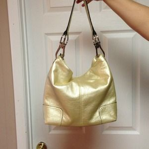 Gold handbags with silver hardware