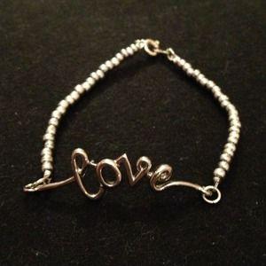 """Silver """"LOVE"""" bracelet."""