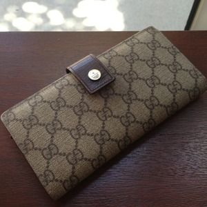 Gucci leather wallet.