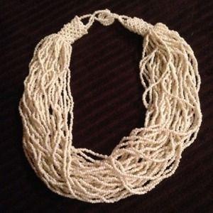 Multi-strand beaded cream colored necklace